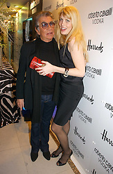 ROBERTO CAVALLI and MEREDITH OSTROM at the launch of Roberto Cavalli Vodka held in the International Designer Room, Harrods, Hans Crescent, London on 5th December 2006.<br />