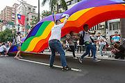 "Running under the rainbow banner at LGBT Pride. The annual march through Taipei's city streets is the largest in Asia, with well over 50 000 people taking part. The 2014 event had the theme ""Walk in Queer's Shoes"", to encourage the wider community to lend their support for equal marriage rights."
