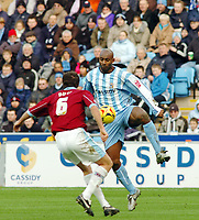Photo: Kevin Poolman.<br />Coventry City v Burnley. Coca Cola Championship. 25/02/2006. <br />Coventry's Dele Adebola (R) looks to go past Michael Duff.
