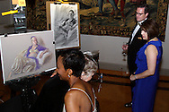Congressman Michael Turner (far right) looks at the drawings of artists Elizabeth Swisher (left) and  James Pate of model Stephanie Elsass during the 2011 Art Ball at the Dayton Art Institute, Saturday, June 11, 2011.