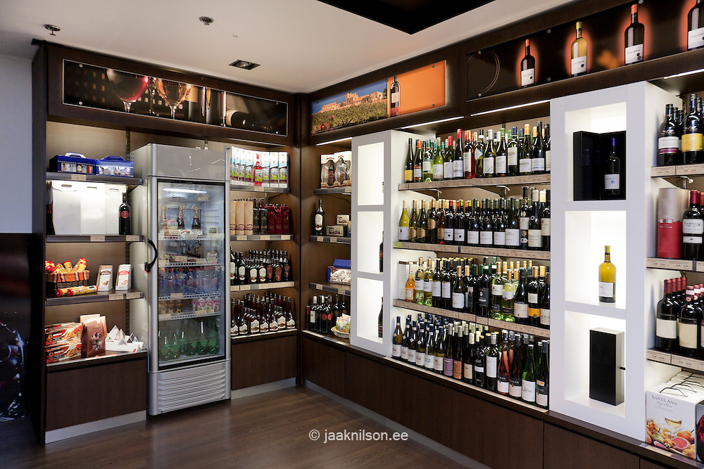 Tallinn airport departure area in Estonia. Tax free, duty free shopping. Luxury goods, alcohol, wine on shop shelves.