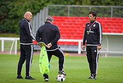 DINARD, FRANCE - Monday, July 4, 2016: Wales' manager Chris Coleman with head of pubic affairs Ian Gwyn Hughes during a training session at their base in Dinard as they prepare for the Semi-Final match against Portugal during the UEFA Euro 2016 Championship. (Pic by David Rawcliffe/Propaganda)