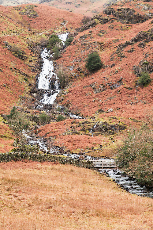 Sour Milk Ghyll, which derives its curious name from its white, swirling waters, is situated near Grasmere. The water flows out of the tarn and descends through a series of impressive waterfalls. The cascades were once known as Churn Milk Force, and Dorothy Wordsworth likened them 'to a broad stream of snow'.