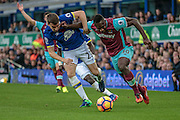 Seamus Coleman (Everton) is held off the ball by Michail Antonio (West Ham United) during the Premier League match between Everton and West Ham United at Goodison Park, Liverpool, England on 30 October 2016. Photo by Mark P Doherty.