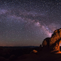 Panoramic image of the Milky Way with Broken Arch in Arches National Park near Moab Utah.