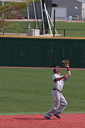 26 April 2014:  Jake Welch fields a high floating ball at the edge of the infield, umpire Tim Catton observes and makes the call during an NCAA Division 1 Missouri Valley Conference (MVC) Baseball game between the Southern Illinois Salukis and the Illinois State Redbirds in Duffy Bass Field, Normal IL
