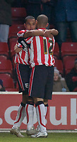 Photo: Alan Crowhurst.<br />Southampton v Milton Keynes Dons. The FA Cup.<br />07/01/2006. <br />Theo Walcott (L) is thanked by Nigel Quashie for his scoring pass for Saints.