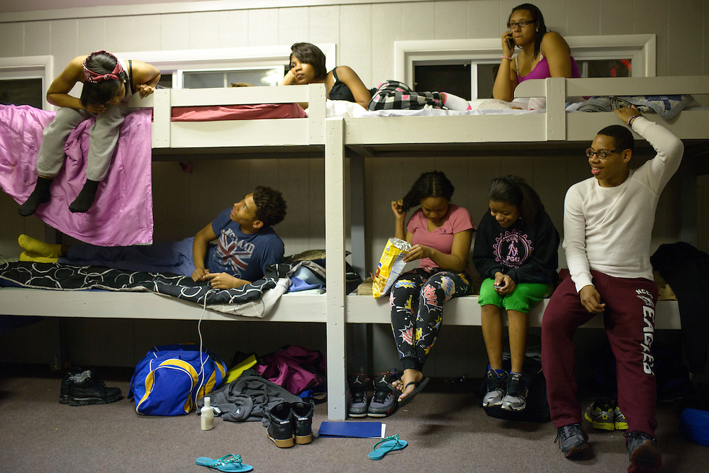 Edgewater, Maryland - April 11, 2014: Students from ACCE and MERVO High Schools hangout before bedtime in one of the bunk rooms during a Peer Group Connection weekend retreat at Camp Letts in Edgewater, Maryland.<br />