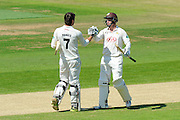 100 for Froakes - Surrey's Ben Foakes is congratulated by Surrey's Gareth Batty on scoring his century during the Specsavers County Champ Div 1 match between Hampshire County Cricket Club and Surrey County Cricket Club at the Ageas Bowl, Southampton, United Kingdom on 18 July 2016. Photo by Graham Hunt.
