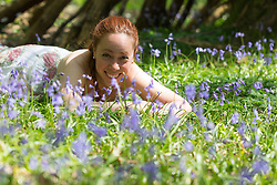 © Licensed to London News Pictures. 21/04/2018. Vigo, UK. Antonella Stacchiotti from Gravesend enjoying Kent bluebells.  The bluebells are now in full bloom at Trosley Country Park Photo in the village of Vigo near to Gravesend in Kent. credit : Rob Powell/LNP