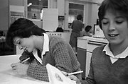 Two girls in cookery class, High Wycombe, UK, 1980s.