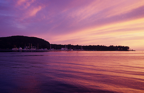 The setting sun casts a purple color in the sky clouds and lake in. & Purple Sunset in Peninsula State Park in Door County Wisconsin ...