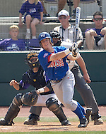 Jayhawks Jared Schweltzer drives a base hit to center field against Kansas State. The Wildcats held on to beat Kansas 5-4 at Tointon Stadium in Manhattan, Kansas, April 23, 2006.