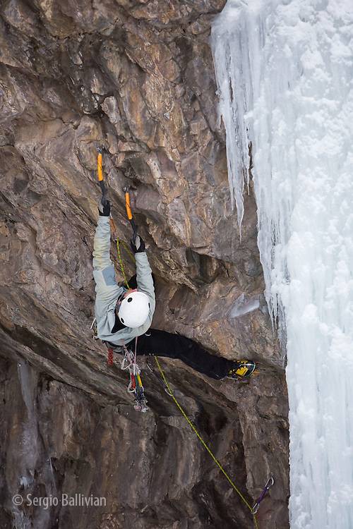 Bryan Gilmore leads a mixed rock/ice climb in Ouray's Ice Park in Ouray, Colorado in the middle of winter.