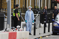 June 4, 2017 - London, London, UK - London, UK.  Police officers investigate the scene after a terror attack that killed 7 people on London Bridge and at Borough Market in central London. (Credit Image: © Tolga Akmen/London News Pictures via ZUMA Wire)