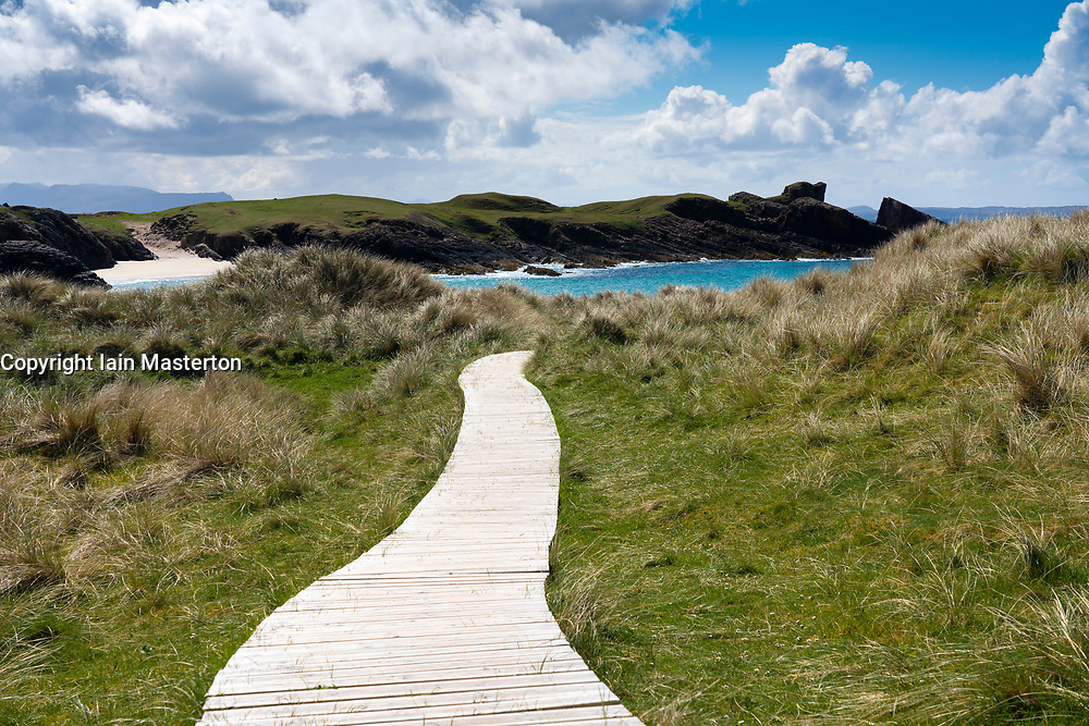 Boardwalk leading through sand dunes to Clachtoll Beach, Highland, Scotland, UK