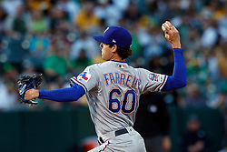 OAKLAND, CA - SEPTEMBER 21:  Luke Farrell #60 of the Texas Rangers pitches against the Oakland Athletics during the first inning at the RingCentral Coliseum on September 21, 2019 in Oakland, California. The Oakland Athletics defeated the Texas Rangers 12-3. (Photo by Jason O. Watson/Getty Images) *** Local Caption *** Luke Farrell