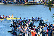 Cambridge. MA. USA.Championship Men's Eights. {left}  Harvard University BC. move on Washington University as both crews move round the bend with spectators crowded onto the Belmont Hill,/ Winsor BC's  pontoon, during the 49th edition of the Head of the Charles.<br /> <br /> <br /> 15:07:17  Sunday  20/10/2013  <br /> <br /> [Mandatory Credit. Peter SPURRIER /Intersport Images]<br /> <br /> Orientation: Landscape