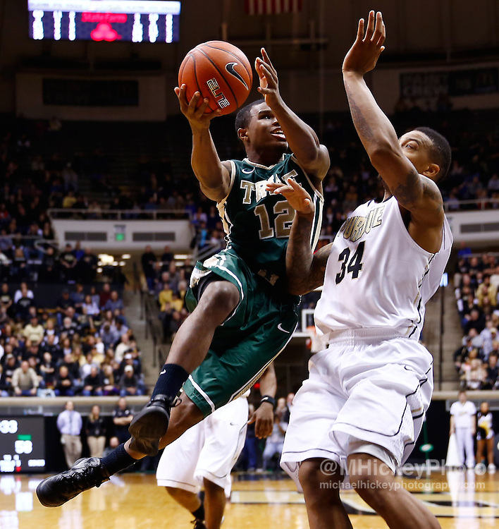 WEST LAFAYETTE, IN - DECEMBER 29: Brandon Britt #12 of the William & Mary Tribe shoots the ball against Jacob Lawson #34 of the Purdue Boilermakers at Mackey Arena on December 29, 2012 in West Lafayette, Indiana. Purdue defeated William & Mary 73-66. (Photo by Michael Hickey/Getty Images) *** Local Caption *** Brandon Britt; Jacob Lawson