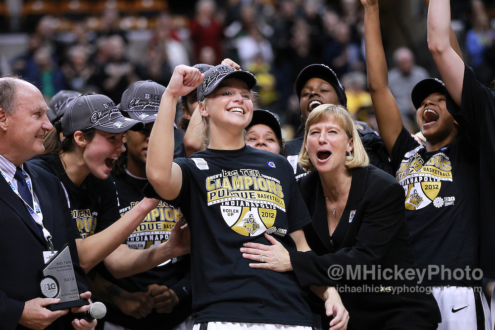 March 04, 2012; Indianapolis, IN, USA; Purdue Boilermakers guard Brittany Rayburn (5) and Purdue Boilermakers head coach Sharon Versyp celebrates the MVP award after the finals of the 2012 Big Ten Tournament at Bankers Life Fieldhouse. Purdue defeated Nebraska 74-70 in 2OT. Mandatory credit: Michael Hickey-US PRESSWIRE