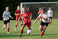 Belmont's McKenzie Phelps gets her foot on the ball ahead of Laconia's Victoria Holmes during the Laconia Belmont NHIAA soccer matchup at Robbie Mills Sports Complex Tuesday evening.  (Karen Bobotas/for the Laconia Daily Sun)