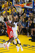 Golden State Warriors forward Draymond Green (23) attempts to block a Houston Rockets shot during Game 3 of the Western Conference Finals at Oracle Arena in Oakland, Calif., on May 20, 2018. (Stan Olszewski/Special to S.F. Examiner)