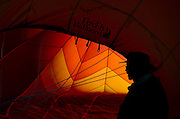 Volunteer crew member Bob Kevan, of Longmont, helps to keep the envelope open while the balloon is readied for flight, Sunday, June 2, 2013, at Centennial Park in Frederick.<br /> (Matthew Jonas/Times-Call)