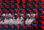 Lunchtime in the business district of Yaesu, as seen reflected off the stock quotation board window of Wako Securities Co. Ltd., Tokyo, 1999.<br /> <br /> &copy; Torin Boyd 2003
