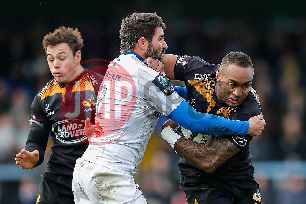 Wasps Winger Sailosi Tagicakibau is tackled by Castres Olympique Hooker Marc-Antoine Rallier and Winger Max Evans - Photo mandatory by-line: Rogan Thomson/JMP - 07966 386802 - 14/12/2014 - SPORT - RUGBY UNION - High Wycombe, England - Adams Park Stadium - Wasps v Castres Olympique - European Rugby Champions Cup Pool 2.