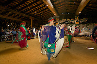 Native dancers celebrate through dance at a festival held in the longhouse in Comox.  Comox, The Comox Valley, Vancouver Island, British Columbia, Canada.