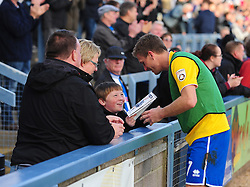 Bristol Rovers' Lee Mansell signs an autograph for a young supporter - Photo mandatory by-line: Neil Brookman/JMP - Mobile: 07966 386802 - 25/10/2014 - SPORT - Football - Dorchester - The Avenue Stadium - Dorchester Town v Bristol Rovers - FA Cup Qualifying with Budweiser