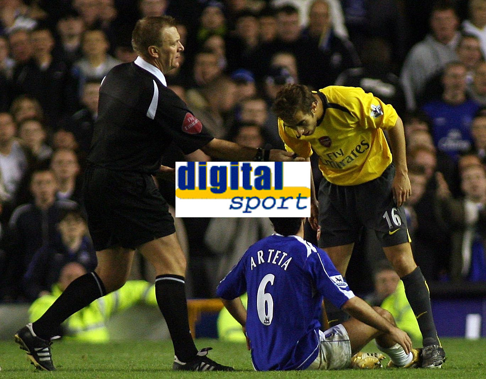 Photo: Paul Thomas.<br /> Everton v Arsenal. Carling Cup. 08/11/2006.<br /> <br /> Referee Graham Poll pulls Arsenal's Mathieu Flamini (R) off Mikel Arteta as they argue.