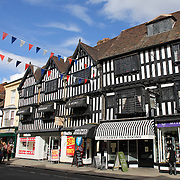 Historic architecture in Stratford-upon-Avon town centre. Stratford-upon-Avon is a market town and civil parish in south Warwickshire, England. It lies on the River Avon. The town is a popular tourist destination owing to its status as birthplace of the playwright and poet William Shakespeare, receiving about 3 million visitors a year. The Royal Shakespeare Company resides in Stratford's Royal Shakespeare Theatre. Photo Tim Clayton