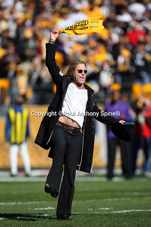 Pittsburgh Steelers fan and country music singer William Kenneth Alphin, also known as Big Kenny, waves a terrible towel after singing the National Anthem before the NFL football game against the Minnesota Vikings, October 25, 2009 in Pittsburgh, Pennsylvania. The Steelers won the game 27-17. (©Paul Anthony Spinelli)