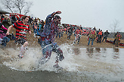 Van Wright, dressed as a zombie, leaps into the bitter cold water at the annual Polar Plunge at Lake Snowdon.