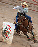 Professional Women's Barrel Racer SHALI LORD, Lamar, CO, clears the barrels in 22.7 seconds, 28 July 2007, Cheyenne Frontier Days