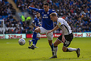 Robert Glatzel of Cardiff City takes on Ben Wilmot of Swansea City during the EFL Sky Bet Championship match between Cardiff City and Swansea City at the Cardiff City Stadium, Cardiff, Wales on 12 January 2020.