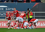 Bristol City players celebrate after Bristol City midfielder Bobby Reid (14) makes it 2-0 during the Sky Bet Championship match between Bristol City and Sheffield Wednesday at Ashton Gate, Bristol, England on 9 April 2016. Photo by Adam Rivers.
