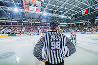 KELOWNA, CANADA - JANUARY 16: Bevan Mills, linesman, stands between the benches of the Kelowna Rockets and the Seattle Thunderbirds on January 16, 2015 at Prospera Place in Kelowna, British Columbia, Canada.  (Photo by Marissa Baecker/Shoot the Breeze)  *** Local Caption *** Bevan Mills; officials; linesman;