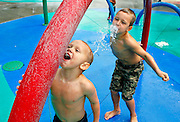 Brothers Tanner, 4, left, and Robinson Wells, 6, of Richland, create their own sprays Thursday at the spray park in Columbia Park in Kennewick. The city has no set date for shutting off water and will base that on weather and attendance. The late summer heat continues today and through this weekend with highs in the mid 90's, according to the National Weather Service.