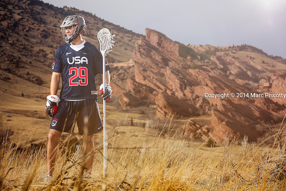 SHOT 2/22/14 4:05:10 PM - Denver Outlaws and Team USA defenseman Lee Zink poses for a portrait with Red Rocks and the foothills just outside of Denver, Co. in the background. Zink was named the 2012 Major League Lacrosse Defensive Player of the Year. When Zink grew up in Darien, Conn., and started his lacrosse career in sixth grade, he knew defense would be his calling card from the beginning. Zink will be playing in Denver this summer in the 2014 FIL World Lacrosse Championships.<br /> (Photo by Marc Piscotty / &copy; 2014)