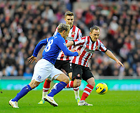 20111226: LONDON, UK - Barclays Premier League 2011/2012: Sunderland vs Everton.<br /> In photo: David Vaughan of Sunderland AFC (R) tries to get past Phil Neville of Everton FC (L).<br /> PHOTO: CITYFILES