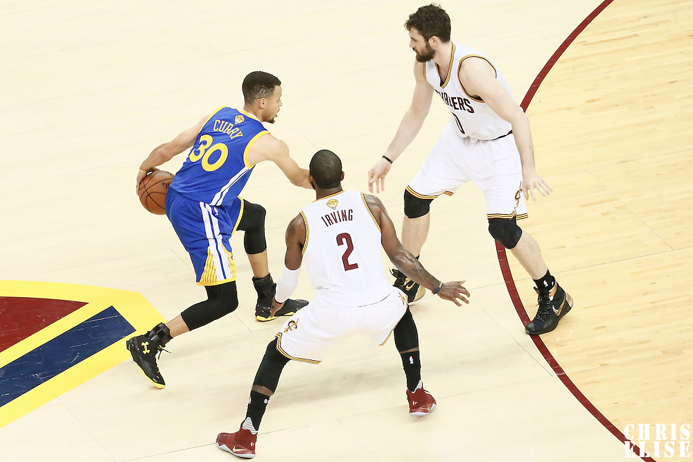 10 June 2016: Cleveland Cavaliers forward Kevin Love (0) and Cleveland Cavaliers guard Kyrie Irving (2) defend on Golden State Warriors guard Stephen Curry (30) during the Golden State Warriors 108-97 victory over the Cleveland Cavaliers, during Game Four of the 2016 NBA Finals at the Quicken Loans Arena, Cleveland, Ohio, USA.