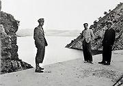 three man posing on dam by mountain lake reservoir Morocco 1930s