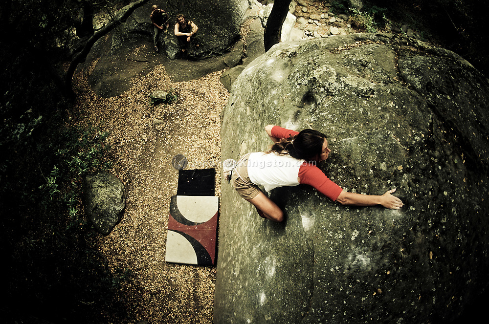 A rock climber climbs at Skofield Park bouldering area, Santa Barbara, California. (releasecode: jk_mr1019, jk_mr1021, jk_mr1017) (Model Released)