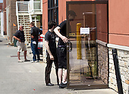 Two people who did not want to be identified go in a back door of Verona in Cedar Falls, Iowa on Tuesday, July 10, 2012.