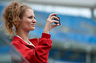 Chorzow, Poland - 2018 June 12: Special Olympics Athlete Daria Mandrela shoots pictures while Closing Ceremony of National Special Olympics Games 2018 at Slaski Stadium on June 12, 2018 in Chorzow, Poland.<br /> <br /> Adam Nurkiewicz declares that he has no rights to the image of people at the photographs of his authorship.<br /> <br /> Picture also available in RAW (NEF) or TIFF format on special request.<br /> <br /> Any editorial, commercial or promotional use requires written permission from the author of image.<br /> <br /> Image can be used in the press when the method of use and the signature does not hurt people on the picture.<br /> <br /> Mandatory credit:<br /> Photo by © Adam Nurkiewicz / Mediasport