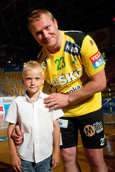 Eduard Koksarov of Celje PL with his  son Sasa during his farewell ceremony after the handball match between RK Celje Pivovarna Lasko and Trimo Trebnje of last Round of 1st Slovenian Handball league, on May 27, 2011 in Arena Zlatorog, Celje, Slovenia. Celje defeated Trimo 32-28 and win 3rd place in Slovenian National Championship. (Photo By Vid Ponikvar / Sportida.com)