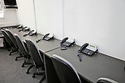 Chairs and landline telephones in television station