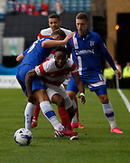 Cedric Evina almost runs underneath Jordan Houghton to break free down the line during the Sky Bet League 1 match between Gillingham and Doncaster Rovers at the MEMS Priestfield Stadium, Gillingham, England on 5 September 2015. Photo by Andy Walter.
